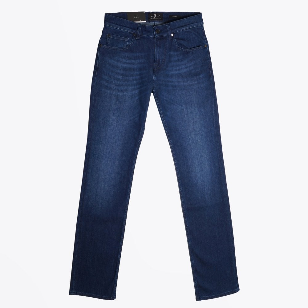 Display of 7 for all mankind slimmy luxe performance jeans in indigo